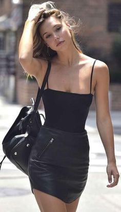 all black. leather mini skirt.