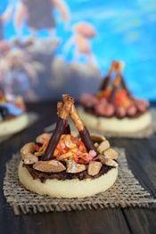 CUB SCOUTS idea: Cute Mini Campfire Cookies from Our Best Bites - These are easy for kids to assemble, so they would make a fun craft, too! Great for a camping, summer camp, outdoor, prehistoric / dinosaur and other birthday party themes