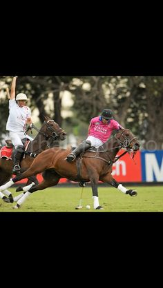 Dream shot for polo?  Amazing play..... showing off perhaps,   the look on the horse's face says it all.