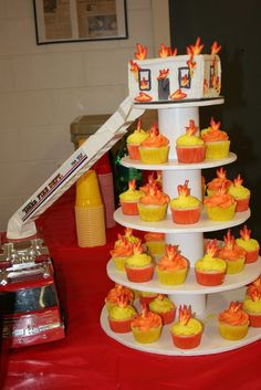 Fireman Burning House Cake With Flame Cupcakes For Grooms Party  on Cake Central