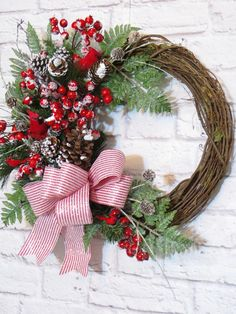 Christmas Wreath, Christmas Cardinal Wreath, Winter Wreath, Christmas Decor On this rustic grapevine wreath, a family of four cardinals is nestled in a winter wonderland of pines, snow tipped berries and pinecones, and icy glazed ferns. A lightly frosted red and white pinstripe bow