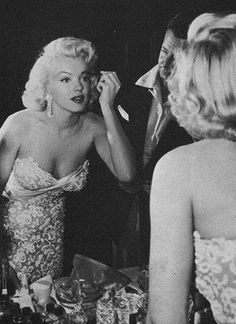 Marilyn applying makeup