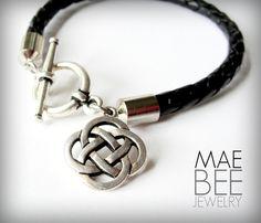 #Celtic knot on black braided leather #bracelet from JewelryByMaeBee on #Etsy.  www.jewelrybymaebee.etsy.com