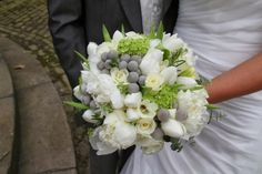 Spring Bridal Bouquet of Tulips, Freesia, Albiflora, Viburnum Opulus, Thalaspi, Rosemary, Roses and Peonies