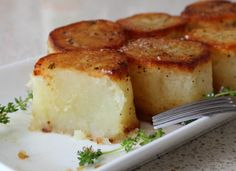 Fondant Potatoes from Chef John at Foodwishes. A bite will feel like pure velvet in your mouth. The rich texture that the potato creates while sizzling in the cast-iron skillet is heavenly:)