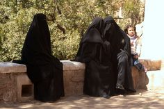 This really true... In Yemen the sharia is strictly enforced. Here three Yemeni women with the burqa and a little girl at Wadi Dhahr.