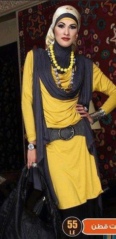 Muslim Hijab is fashionable. A little less make up would make this more chic. imho