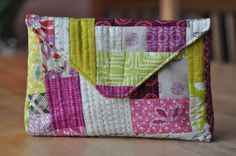 Envelope pouch tutorial.....with a quilt as you go illustration.  Nice!