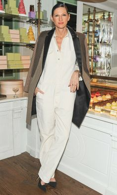 Jenna Lyons looks effortlessly chic at the Laduree Store Opening in New York, layering a long-line blazer over a white jumpsuit.