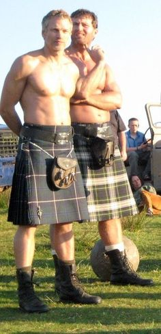 2 boys in kilts. I love them. The kilts I mean.....Not the big muscly, beautiful men.....no, that would be weird.....Did I mention their muscles?