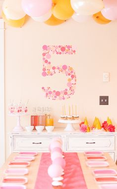 Need a party theme for a party that's pulling double duty? Choose BUBBLES! This links to a Bubbly Themed 5th Birthday & Going Away Party. Bubbles & balloons for the kids, bubbly Prosecco & Rose for the adults! I love the shades of pink, citrus, and gold here.
