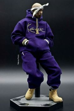 Eric Daye 's Tupac Shakur custom 1/6 scale figure. Sculpt by Daco Yoo , Kani sweatsuit by Yunsil , Death Row pendant and bandana by CORROSE. Boots painted by JD Kim . Shot by Tirso Mena for TMena Photo