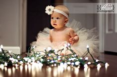 Baby caught in the Christmas lights