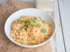 Looking for a quick and easy, delicious and filling meal? How about a healthy, vegan Carrot Rice? It's topped with cilantro and homemade cashew parmesan.