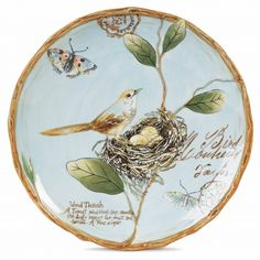 The decorative toulouse salad plate features a bird in its nest, as well as butterfly and floral accents, with a twig border. Colorful birds, butterflies and delicate floral accents appear on a pastel blue background in the charming Toulouse Collection by Fitz and Floyd. Add a breath of the French countryside to your home decor with our collection of dinnerware, serving pieces and home decor. This versatile pattern is made of durable stoneware and is dishwasher and microwave safe.