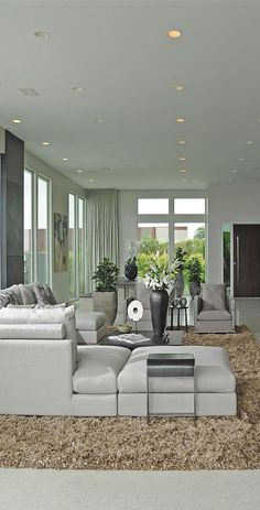 Gray living room charisma design - Unique Home Architecture
