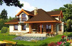 Casa placata cu piatra si balcoane din fier forjat