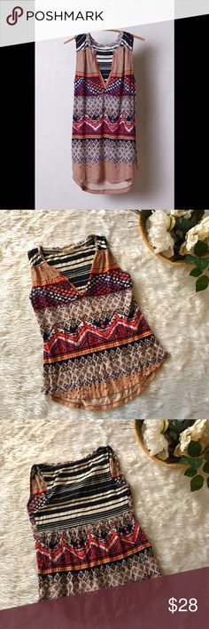 Meadow Rue Patterned V-Neck Tank This tank is in excellent condition! Size XXS  Pit to pit is approx 16 inches  Length is approx 22 inches  All measurements are from flat lays  Smoke and pet free home! No flaws like stains or holes! No modeling No trades! OFFERS WELCOME!😊 Anthropologie Tops Tank Tops