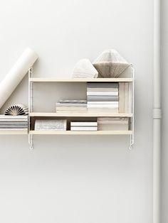 String Pocket is a compact and elegant shelf for books, collectables and other small items. Launched in 2005 by the Swedish manufacturer String, String Pocket is part of the popular collection designed by Nils Strinning in String Pocket, Scandinavian Shelves, Scandinavian Design, Nordic Design, String Regal, String Shelf, Cd Shelf, String System, Etagere Design