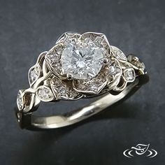 Diamond lotus engagement ring from Green Lake Jewelry. Would be really pretty with a colored stone - maybe teal or lavender.