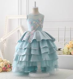 NEW ARRIVALS! Baby Blue Flower Applique Gown----Made To Order - High Quality Sleeveless Floor Length Tiered Layered Sheer Neckline Little Girl Party Dress Perfect for Birthday, Wedding, Christmas, Communion or any special day. Available from 1 until 13 years old Material: Satin, tulle mesh, cotton Color: Baby Blue/Custom Color We don't have size guide for this dress, so please leave us your little girl's measurement (Bust, waist, waist to floor and hollow to floor) at checkout.