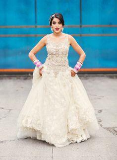 Love this white indian bridal dress/lengha #weddings #lengha #bridaldress | Image courtesy of Nimboo Photography | For more wedding inspiration visit www.shaadibelles.com