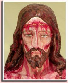 Statue of Scourged Jesus, this is an example of an impression on Jesus' forehead that was from the crown of thorns, it was forced placed onto Jesus' head.