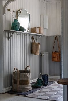 Entryway with two-toned vertical paneling and wall shelf with hooks Wall Shelf With Hooks, Wall Shelves, Comedor Office, White Wash Walls, Two Tone Walls, Mudroom, Interior Inspiration, Sweet Home, Room Decor