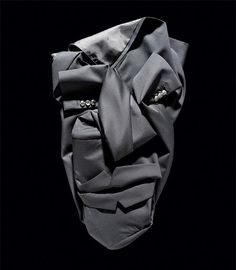 Faces made of clothing. 1 garment per face! Created by New York based photographer Bela Borsodi.