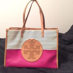Authentic Tory Burch viva mini Ella tote! Authentic Tory burch bag!!! The outside is in great condition but there are scratches and a few marks on the inside (could probably come out if you tried). The bag is a beautiful dark pink and there is a small pocket in the front of the bag. The inside has a zipper pocket and 2 side pockets. Love the bag just rarely use it! Tory Burch Bags Shoulder Bags