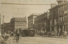 Jackson MI RPPC GREAT Busy Downtown Street Car Era Historical LOOK Hotels Cafes Webbs Drugs Cowleys Shoes Clothing Store