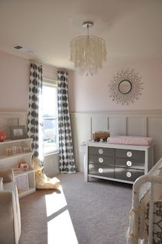 pink nursery, chandelier, grey curtains, painted changing table, Marianne Strong Interiors