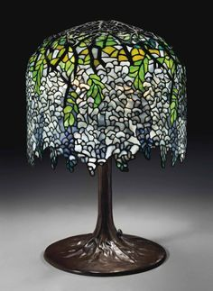 """Tiffany Studios, New York, Favrile Leaded Glass and Patinated Bronze """"Wisteria"""" Lamp."""