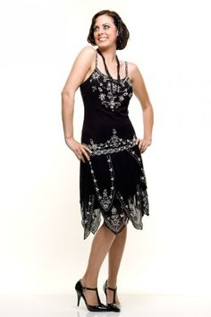 This is a DIVINE flapper style dress for your consideration! It has a jet black color with generous silver deco style be...Price - $180.00-BtPlXMZN