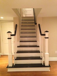 Most charming basement stairs in #ShortHillsNJ - painted black and widened at the bottom w/cool bannister