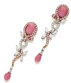 PAIR OF CONCH PEARLS, PINK DIAMOND & DIAMOND PENDENT EARRINGS.  Each oval pink conch pearl, set within a surround of pink diamonds, suspending articulated scrolls of brilliant-cut diamonds & pink diamonds, enhanced by a pear-shaped pink diamond of intense hue & marquise-shaped diamonds, anchored by a conch pearl drop, mounted in 18 karat white and pink gold. by eddie