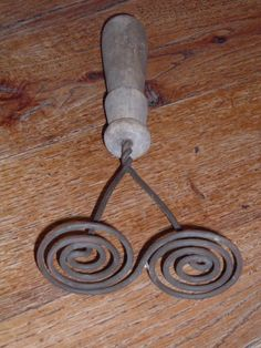An old potato masher -- such a beautiful design for an everyday kitchen tool!