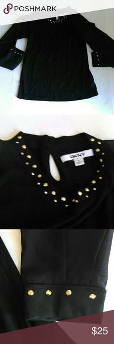 DKNY black top with gold rhinestones sheer sleeves DKNY black long sleeve top with gold rhinestones around the neck in front and at the cuffs of the arms. The arms are also sheer. Keyhole cut out in back as shown in last pic. In great condition. No rips stains or tears. Size large. Chest measures approx 14 inches across laying flat. DKNY Tops Blouses