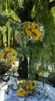 Yellow centerpieces..Roses and Sunflowers.