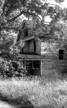Forgotten home, the screened porch would have been so relaxing in the summer.