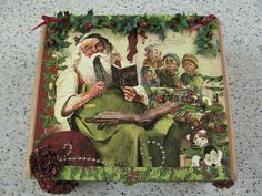 This is an altered Cigar Box that i created using the Graphic 45 Christmas Emporium papers!