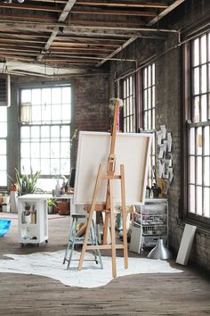 LaBelleMariposa - love the light and huge easel. Details like the star on the floor make this space even more special. Katie Stratton's amazing studio space