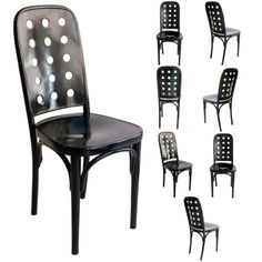Vienna Secession set of 8 dining chairs in black lacquered beech wood with 15 holes in back seat by Josef Hoffmann, manufactured by J. & J. Kohn, c. 1910.