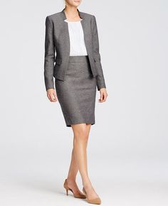 """Sharpen your look with our iconic pencil skirt, smartly rendered in refined tweed. Hidden back zipper with hook-and-eye closure. Back vent. Lined. 23"""" long."""