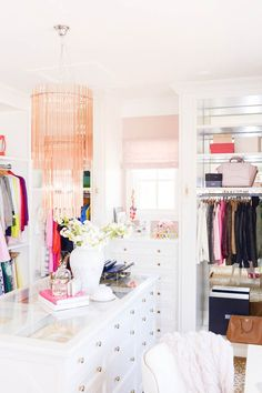 Rach Parcell's closet. The closet was designed by Alice Lane and features a shoe room, leopard carpet, gold hardware, and a glam pink Lucite chandelier