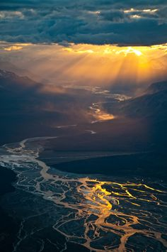 Dark clouds and golden light make a dramatic sky, Kluane National Park, Canada.  Portal to Where?