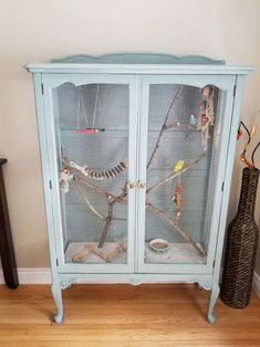 My very first DIY indoor aviary that I repurposed from an old china cabinet. Bra… My very first DIY indoor aviary that I repurposed from an old china cabinet. Branches are natural from the trees in my backyard. Diy Bird Cage, Decorative Bird Cages, Diy Bird Toys, Diy Toys, Diy Budgie Toys, Bird Aviary, Pet Cage, Vivarium, Budgies