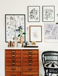 Dresser styled with vases and framed artwork