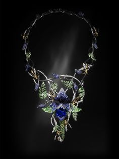 This. Is. Gorgeous. Is it a necklace? I love the purple iris! (or maybe that's an orchid?)