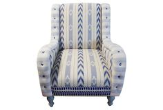 Kenza Chair.  This blue and white chair reflects a beachy, bohemian lifestyle with its mix of ikat stripes, ikat paisley, and cotton stripes on the arm. The legs conveniently un-screw for easy entry through doorways. Made in the USA.